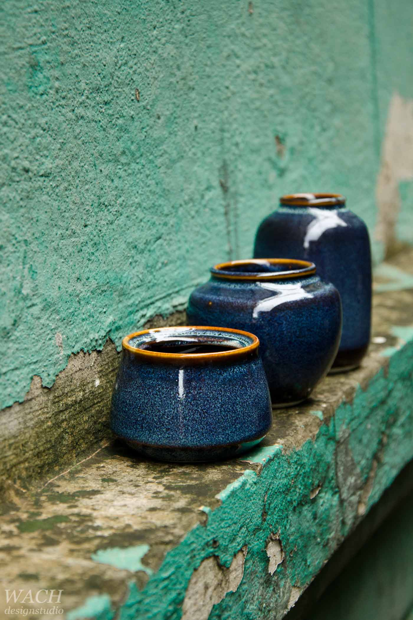 Phuc Duy ceramic vases lined up on a fasade near Hanoi Design Centre