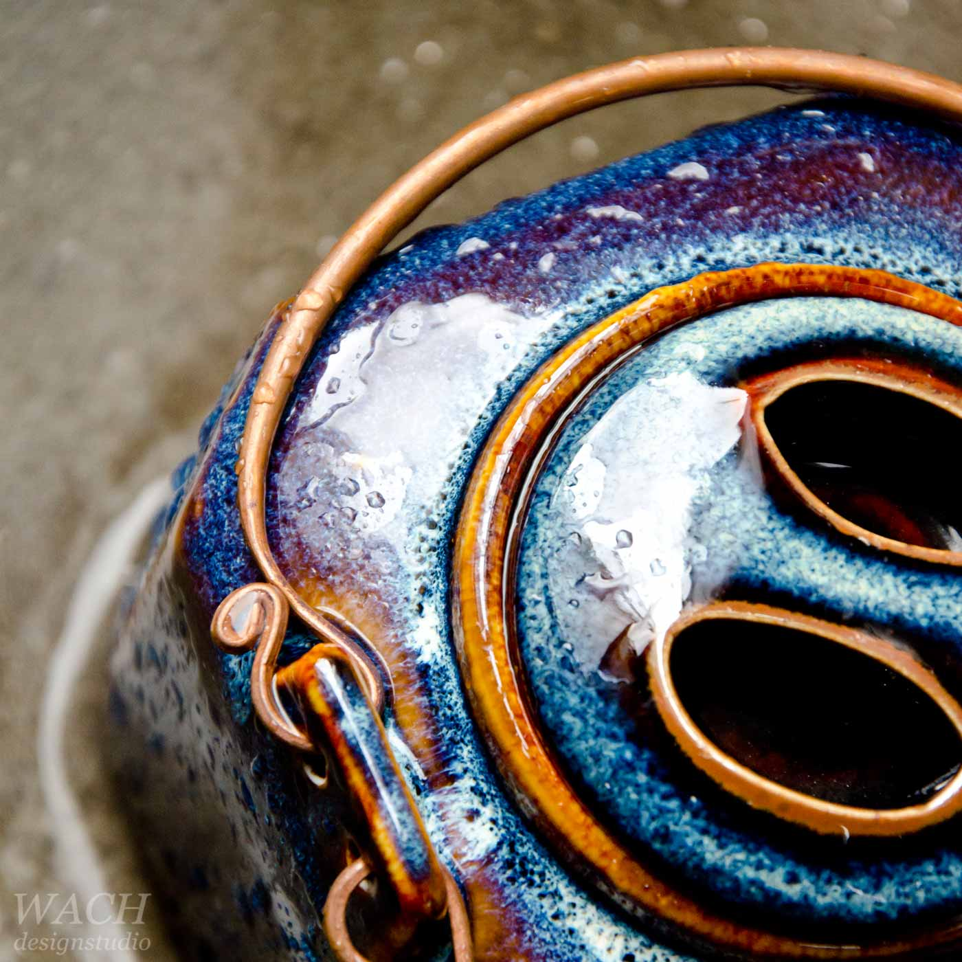 Ocean blue Phuc Duy Teapot photographed in the rain