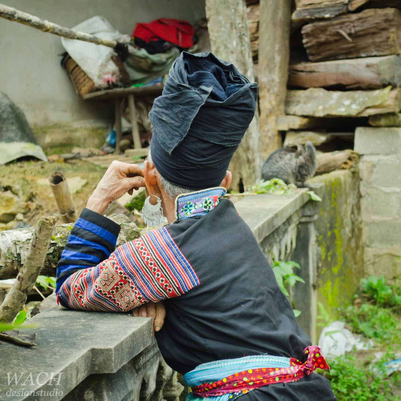 Elderly Hmong woman daydreaming