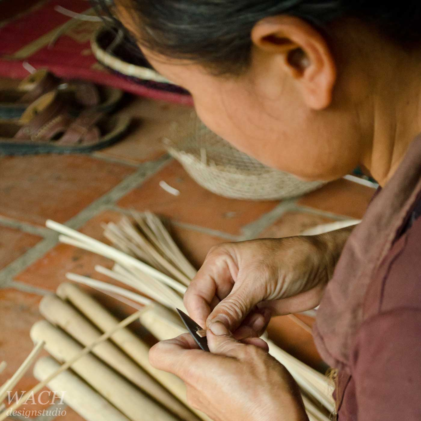 Vietnamese women crafting bamboo stripes for basket weaving