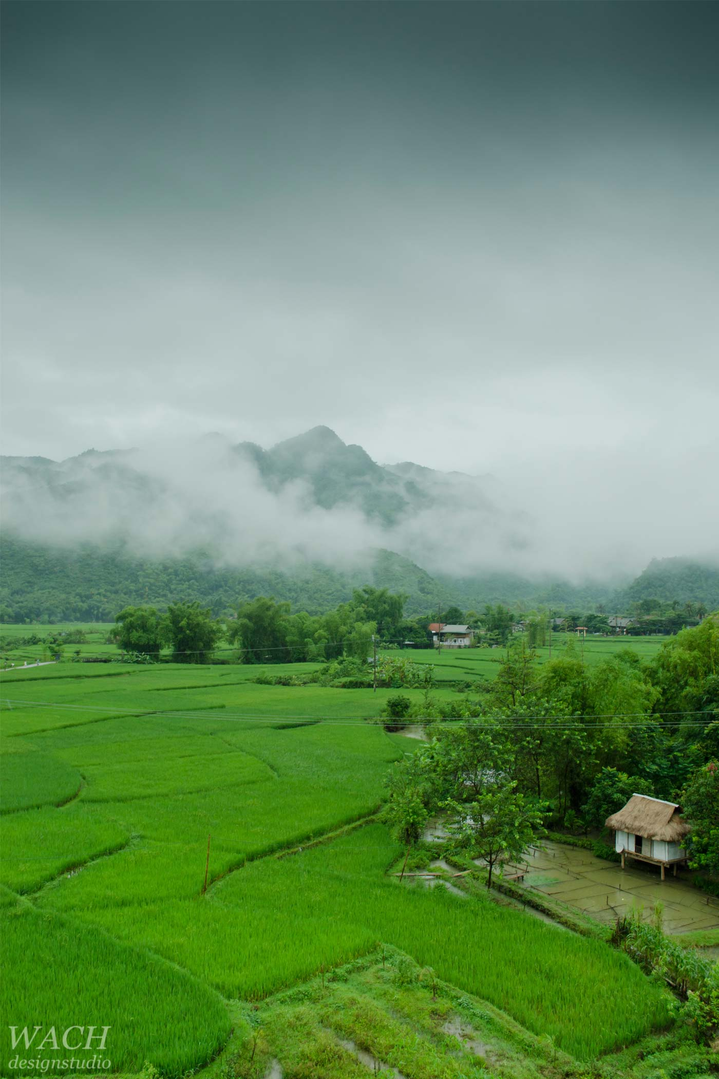 Hmong valley close to Hanoi with befogged mountains in the back
