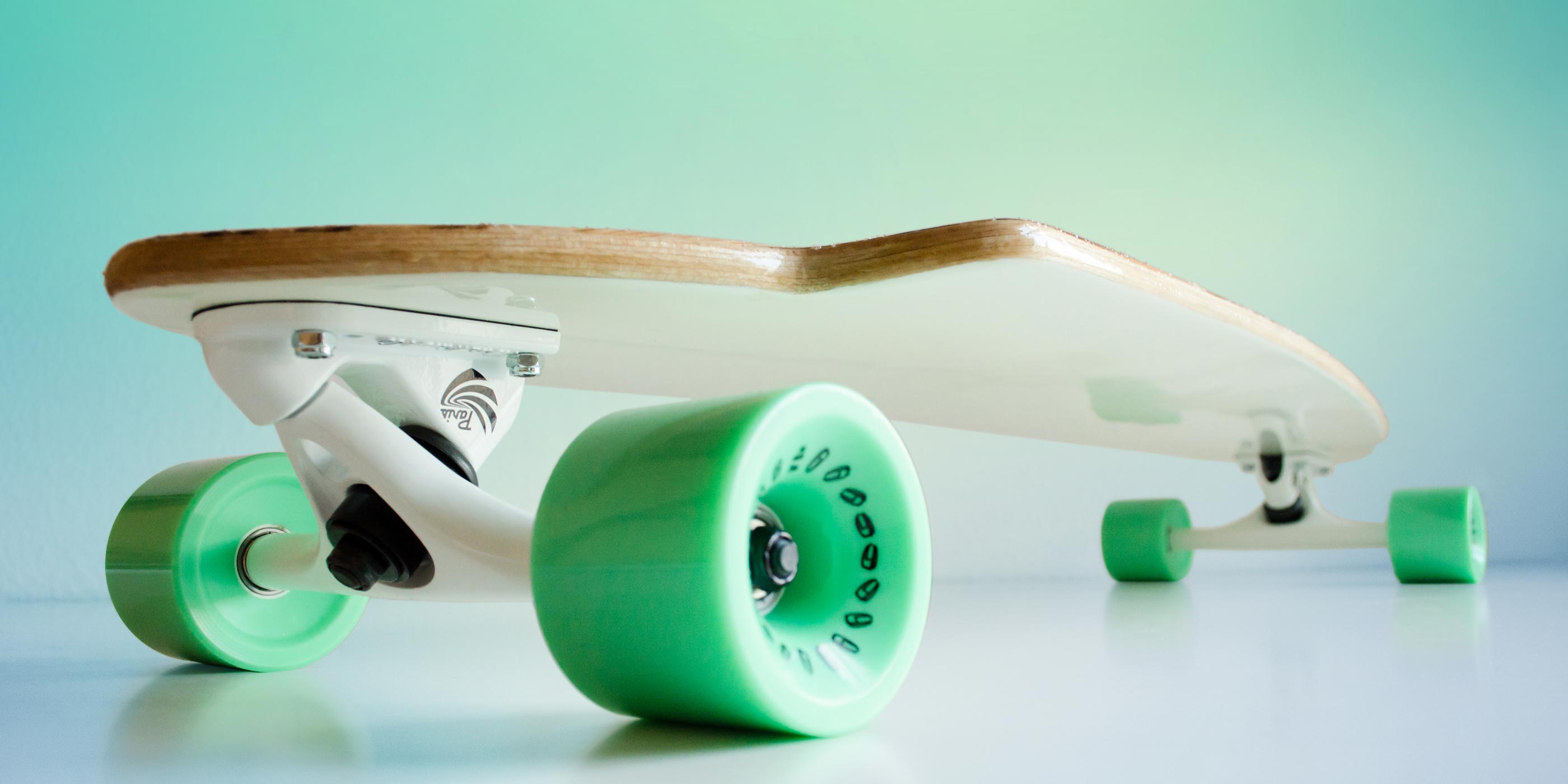 Longboard by WACH designstudio with Zebrano Deck, white bottom, Paris Trucks and turquoise Olson&Hekmati wheels