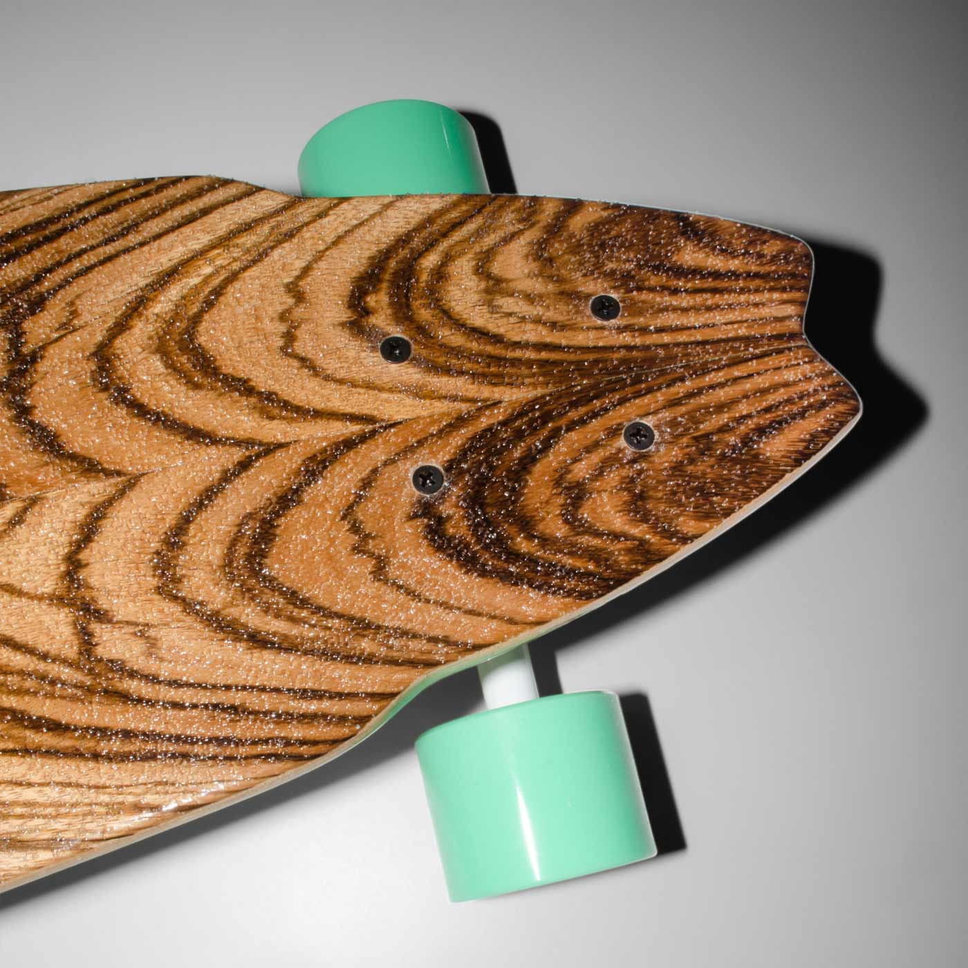 Detail of the WACH designstudio longboard tail deck covered with mirrored zebra wood veneer